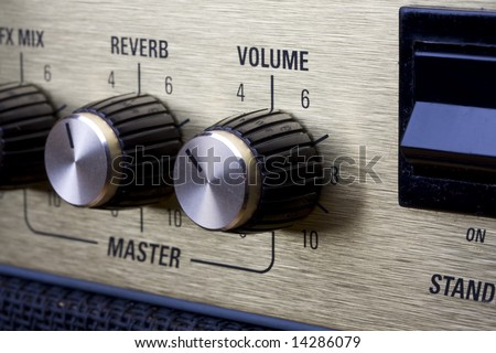 detail of an golden electric guitar amplifier - stock photo