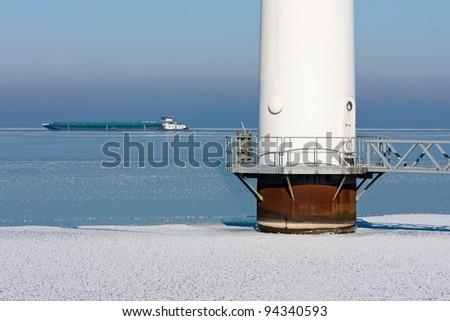 Detail of an offshore windturbine in a frozen sea - stock photo
