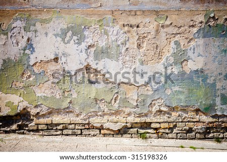 Detail of an old cracked cement wall texture   - stock photo