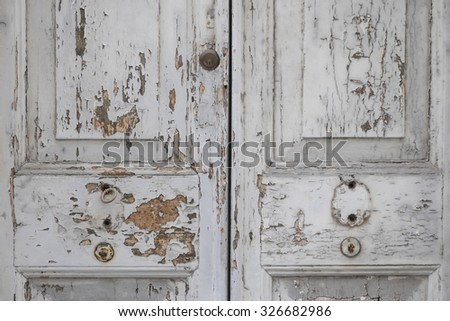 Detail of an old door with white cracked paint background - stock photo