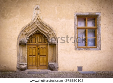 Detail of an old, historical Facade with typical stone seats from the 16th century in the medieval town Wittenberg, Germany, late gothic style. - stock photo