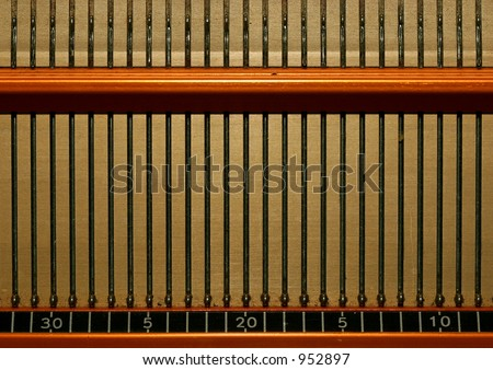 Detail of an old knitting machine - stock photo