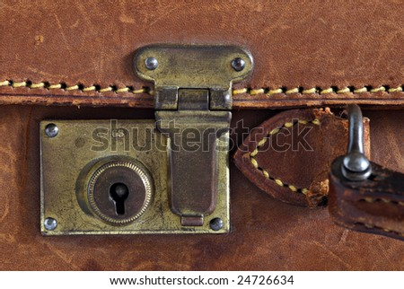 Detail of an old leather suitcase - stock photo