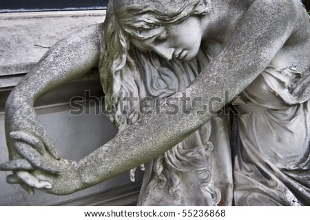 detail of an old marble fombstone at the central cemetery in Vienna - stock photo