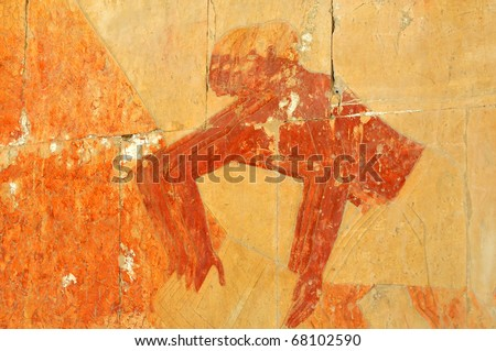 Detail of ancient Egyptian bas-relief of workmen shovelling Henna - stock photo