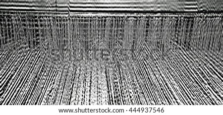 detail of ancient loom in the textile industry for the production of woolen blankets - stock photo