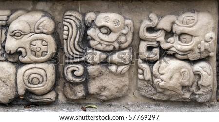 Detail of ancient Mayan Gods and demons at Copan, Honduras. - stock photo