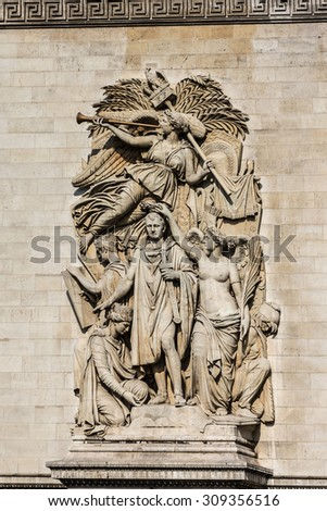 Detail of Arc de Triomphe de l'Etoile - one of most famous monuments in Paris. Arc de Triomphe (1836) was built by architect Jean Shalgrenom by order of Napoleon to commemorate victories of his Army. - stock photo