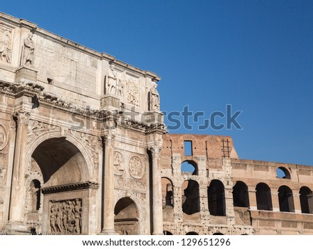 Detail of arch of Constantine and Colosseum in Ancient Rome - stock photo