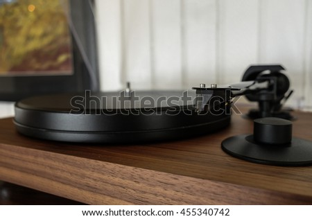 Detail of arm with cartridge on record player for LP vinyl discs  - stock photo