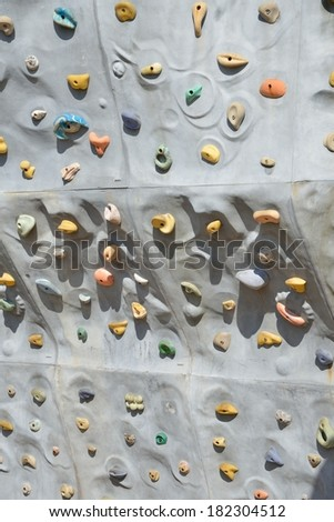 Detail of artificial rock wall for sports climbing - stock photo