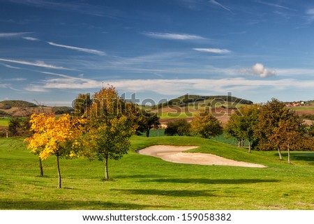 Detail of autumn golf course - stock photo