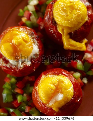 Detail of baked filled tomatoes - stock photo