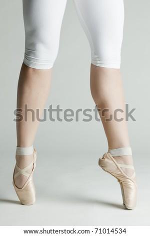 detail of ballet dancer's feet - stock photo
