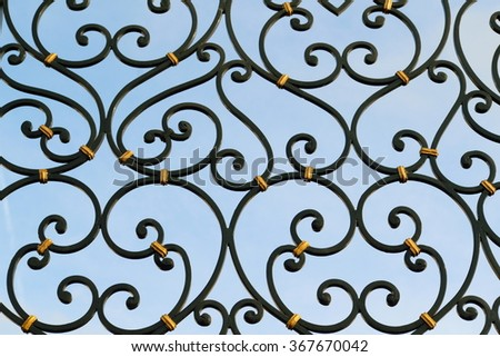 Detail of beautiful ironwork gate painted in black - stock photo