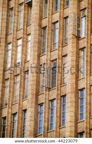 Detail of beautiful old building with several metal windows open - stock photo