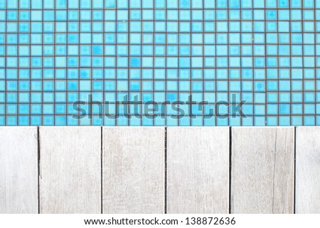 detail of beautiful wooden deck and swimming pool edge - stock photo