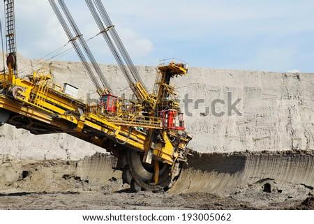 detail of big wheel brown coal mine excavator - stock photo