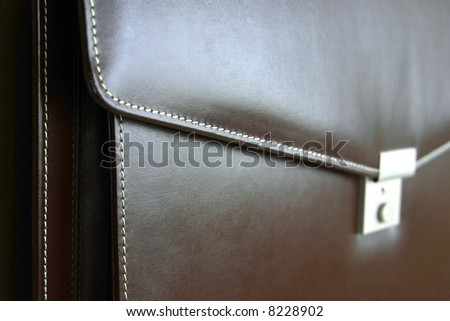 Detail of bio suitcase made with materials of vegetable origin. - stock photo