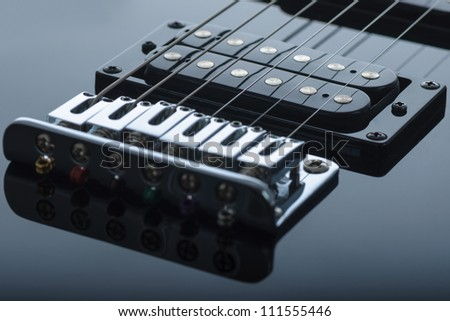 Detail of black electric guitar - stock photo