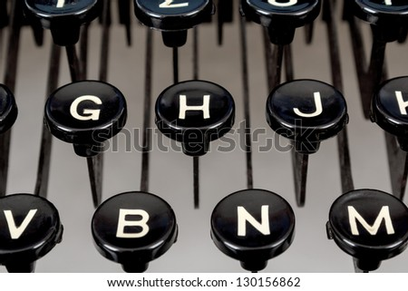 detail of black keys on retro typewriter - stock photo