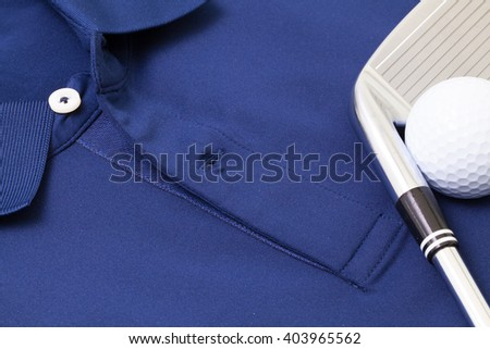 Detail of blue polo shirt and golf equipments - stock photo