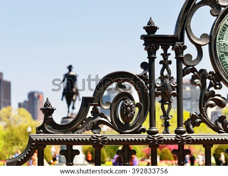 Detail of Boston Public Garden gate, George Washington statue in background - stock photo
