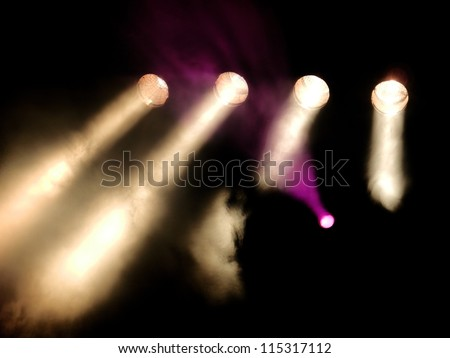 Detail of bright violet and red concert lights - stock photo