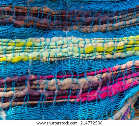 Detail of brightly coloured, woven scarf - stock photo