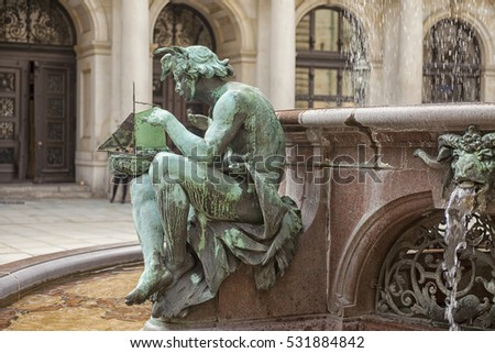Detail of bronze statue on the fountain in the old city hall of Hamburg