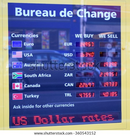 Detail of Bureau de Change with displayed exchange rates - stock photo