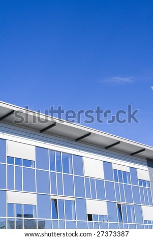 Detail of business building, diagonal, with blue tint - stock photo