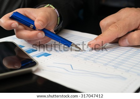 Detail of business people at work in their office - stock photo