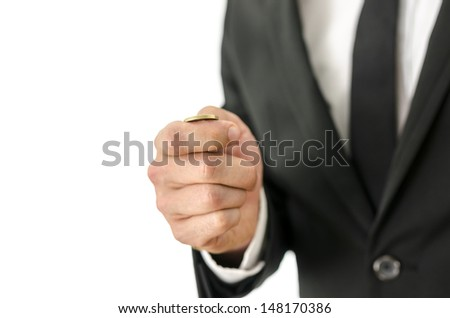 Detail of businessman tossing a coin. Isolated over white background. - stock photo