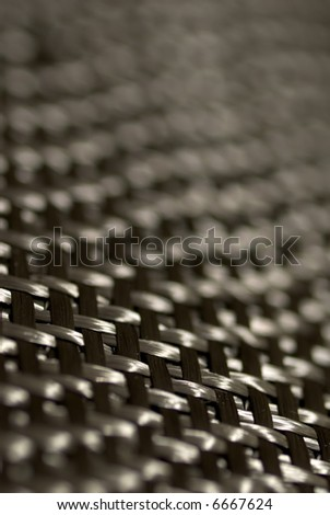 Detail of carbon fiber weave. - stock photo