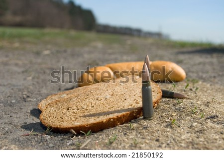 detail of cartridges and pieces of bread - fight and czech - two face of war - stock photo