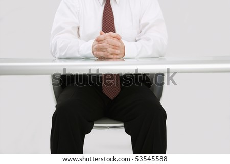 Detail of Caucasian middle aged businessman sitting at desk. - stock photo