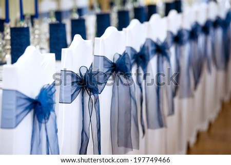 detail of chairs with decoration at the wedding reception - stock photo