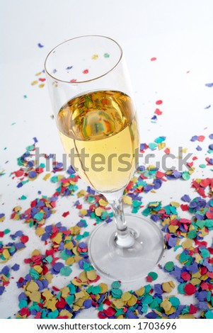 Detail of champagne glass and confetti