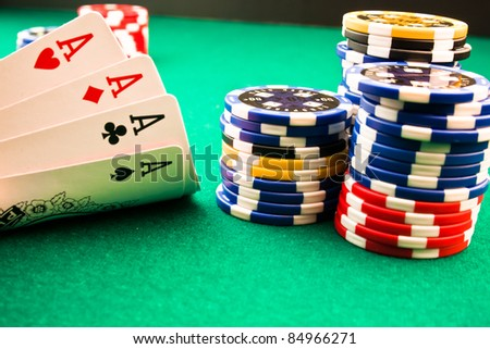 Detail of chips poker and poker aces - stock photo