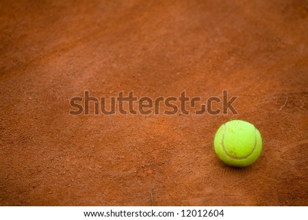 Detail of clay tennis court with Tennis ball. Useful for tennis background designs - stock photo