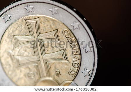 detail of coin eur on dark background - stock photo