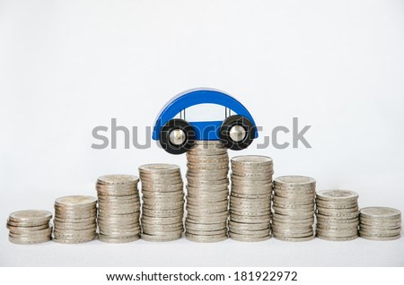 detail of coins and car on white background - stock photo
