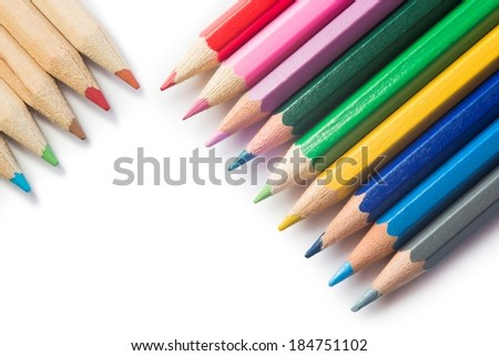 Detail of colored crayons on white background