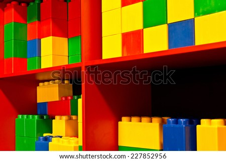 detail of colored cubes in the red shelf - stock photo