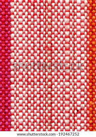 Detail of colorful fabric pattern background.