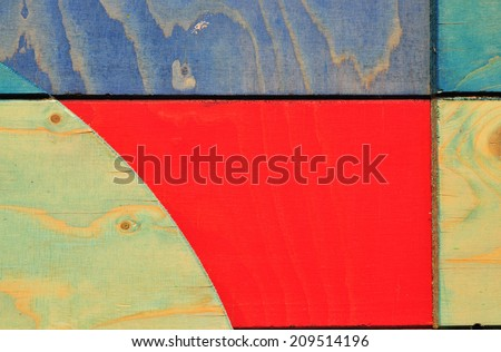 Detail of colourful temporary stained timber screening around London construction site. - stock photo