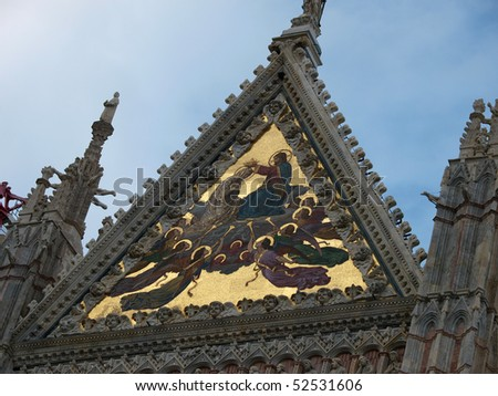 Detail of Coronation of the Virgin mosaic (1878) at the top of the west facade. Duomo, Siena, Italy. - stock photo