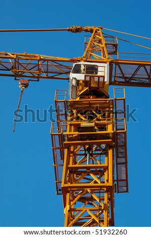 Detail of crane with blue sky in background