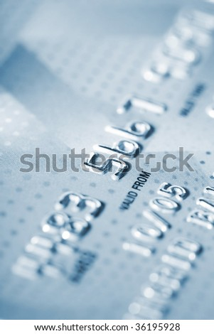 Detail of credit card as background in blue tone - stock photo